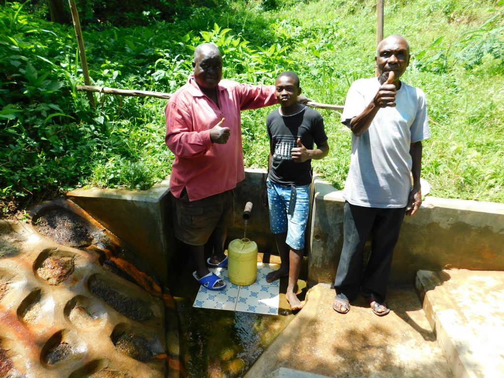 The Water Project : 5-kenya18157-thumbs-up-for-clean-water-tom-musa-in-center