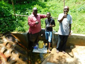 The Water Project:  Thumbs Up For Clean Water Tom Musa In Center