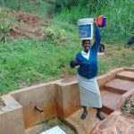 The Water Project: Chepnonochi Community, Chepnonochi Spring -  Christine Ready To Take Her Water Home