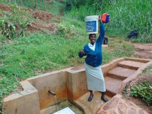 The Water Project:  Christine Ready To Take Her Water Home