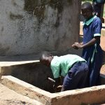The Water Project: Mukunyuku RC Primary School -  Students Using The Water