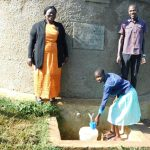 The Water Project: Eshikufu Primary School -  Head Teacher Osundwa Vivian And Field Officer Protus At The Rain Tank