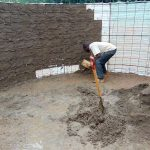 The Water Project: Magaka Primary School -  Cementing Inside Rain Tank