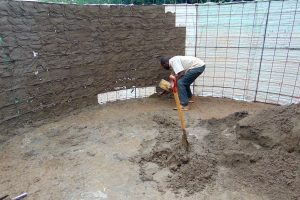 The Water Project:  Cementing Inside Rain Tank