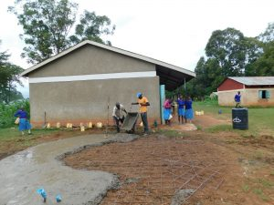 The Water Project:  Pouring Cement For Rain Tank Foundation