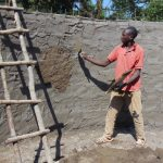 The Water Project: Lwanga Itulubini Primary School -  Cementing Interior Of Tank