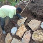 The Water Project: Shihungu Community, Shihungu Spring -  Rub Wall Construction