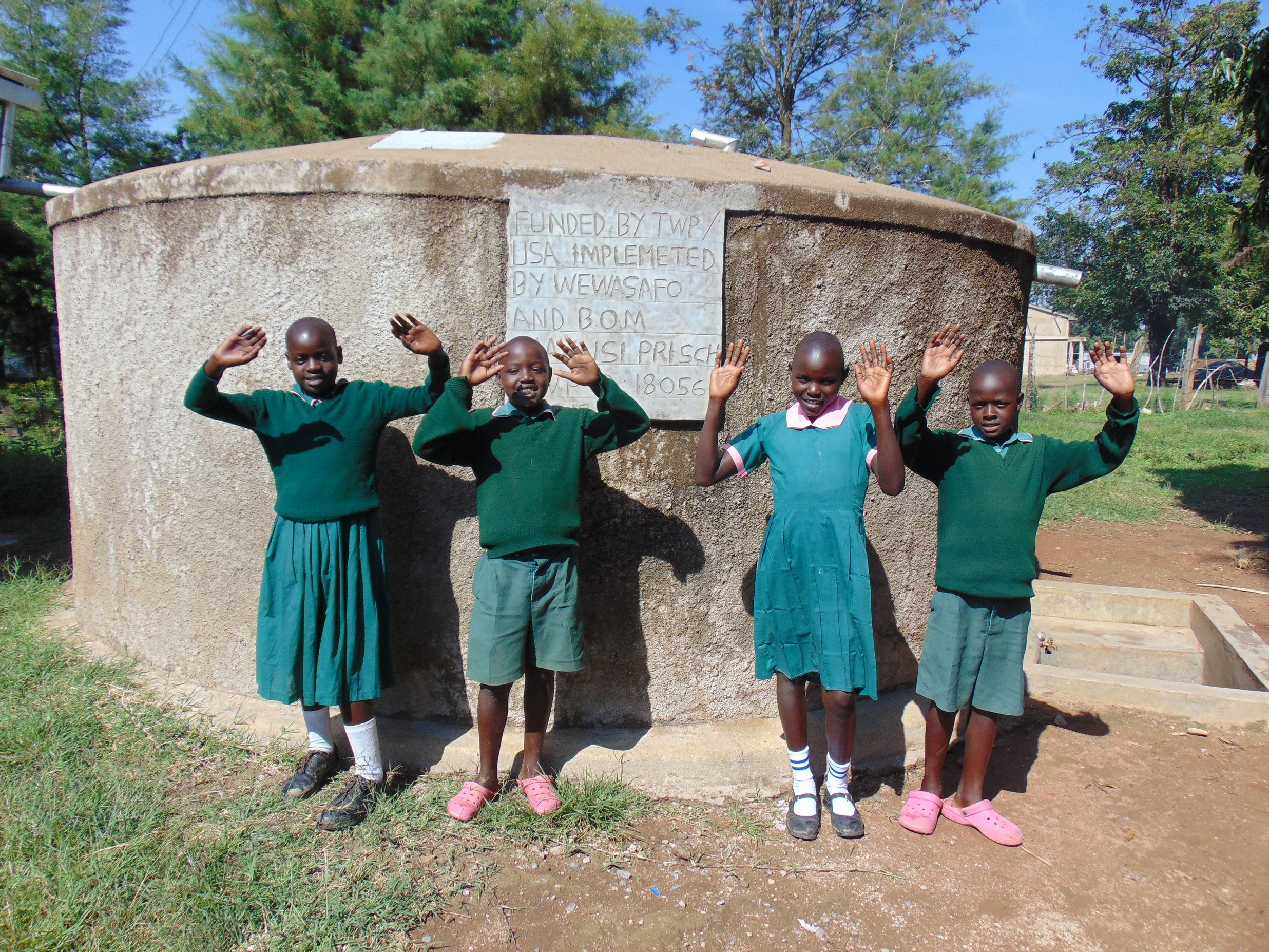The Water Project : 6-kenya18079-happy-faces-at-the-rain-tank