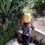 The Water Project: Matsakha Community, Mbakaya Spring -  Karen Carrying Water