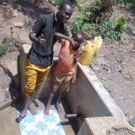 The Water Project: Matsakha Community, Siseche Spring -  Alex Injendi With A Child At The Spring