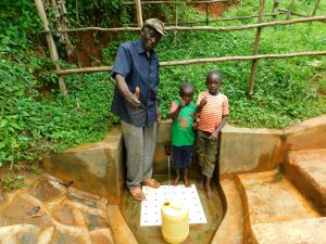 The Water Project:  John Omusembi With Kids At Spring