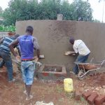 The Water Project: Magaka Primary School -  Cementing Outside Of Rain Tank