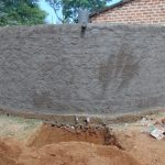The Water Project: Lwanga Itulubini Primary School -  Rain Tank With Fresh Cement