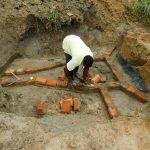 The Water Project: Ikonyero Community, Amkongo Spring -  Brick Setting