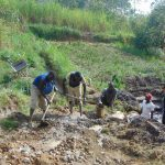 The Water Project: Sasala Community, Kasit Spring -  Community Members Help Mix Concrete