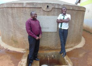 The Water Project:  Mr Sandagi With A Student Enjoying A Laugh