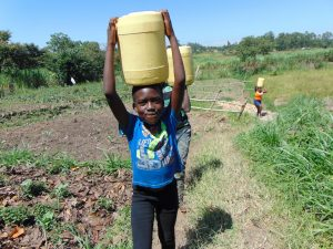 The Water Project:  Carrying Spring Water Home