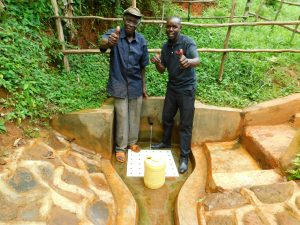 The Water Project:  John Omusembi With Field Officer Wilson Kipchoge