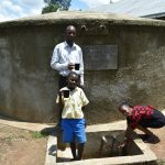The Water Project: Ikoli Primary School -  Mr Chitechi Cheinster And Betty At The Rain Tank