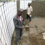 The Water Project: Kimangeti Primary School -  Cementing Inside The Tank