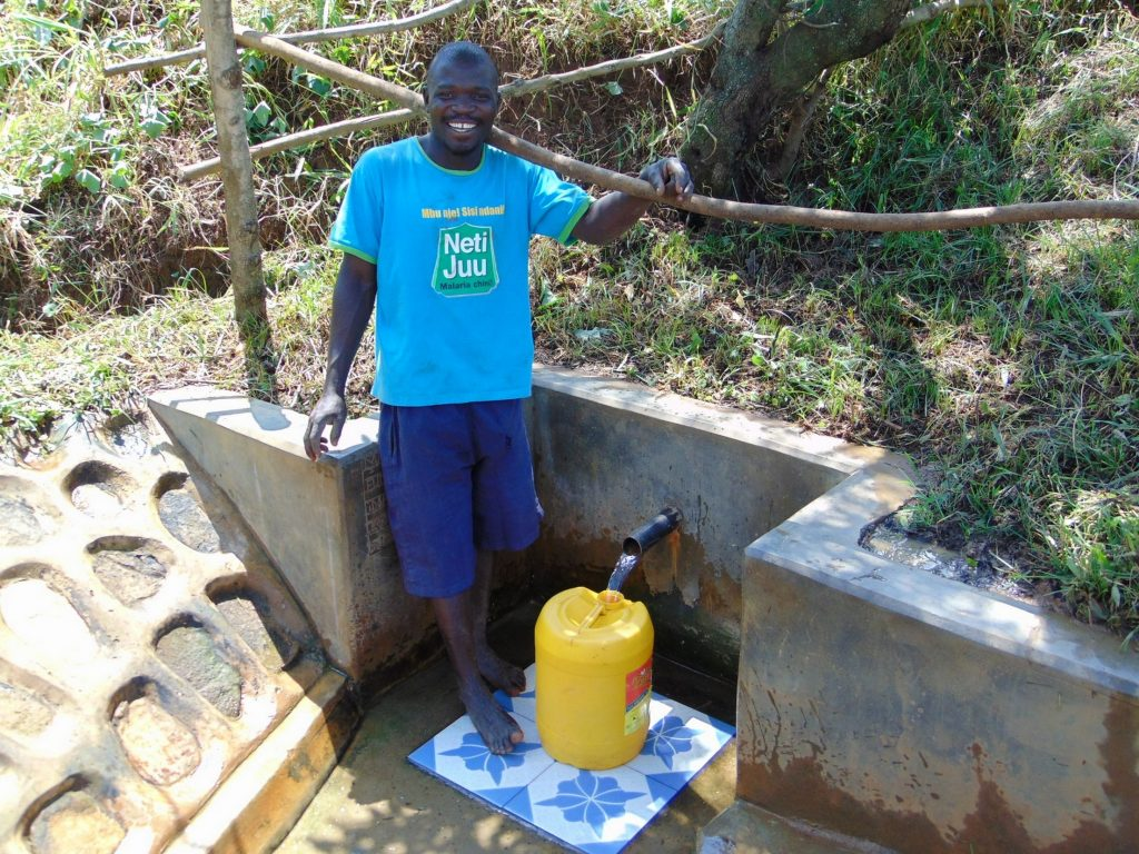 The Water Project : 8-kenya18140-charles-mutwaro-fetches-water