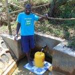 The Water Project: Mungaha B Community, Maria Spring -  Charles Mutwaro Fetches Water