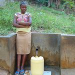 The Water Project: Upper Visiru Community, Wambosani Spring -  Agnes Lidambiza Fetches Water