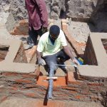 The Water Project: Ikonyero Community, Amkongo Spring -  Pipe Setting