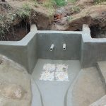The Water Project: Sasala Community, Kasit Spring -  Two Discharge Pipes And Tiles Set