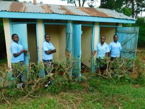 The Water Project:  Girls Outside Their Latrines