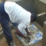The Water Project: Shihungu Community, Shihungu Spring -  Tile Setting