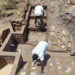 The Water Project: Ikonyero Community, Amkongo Spring -  Working On The Rub Walls And Stairs