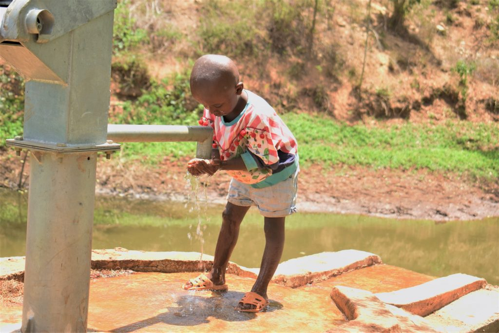 The Water Project : kenya18185-child-drinks-from-the-well