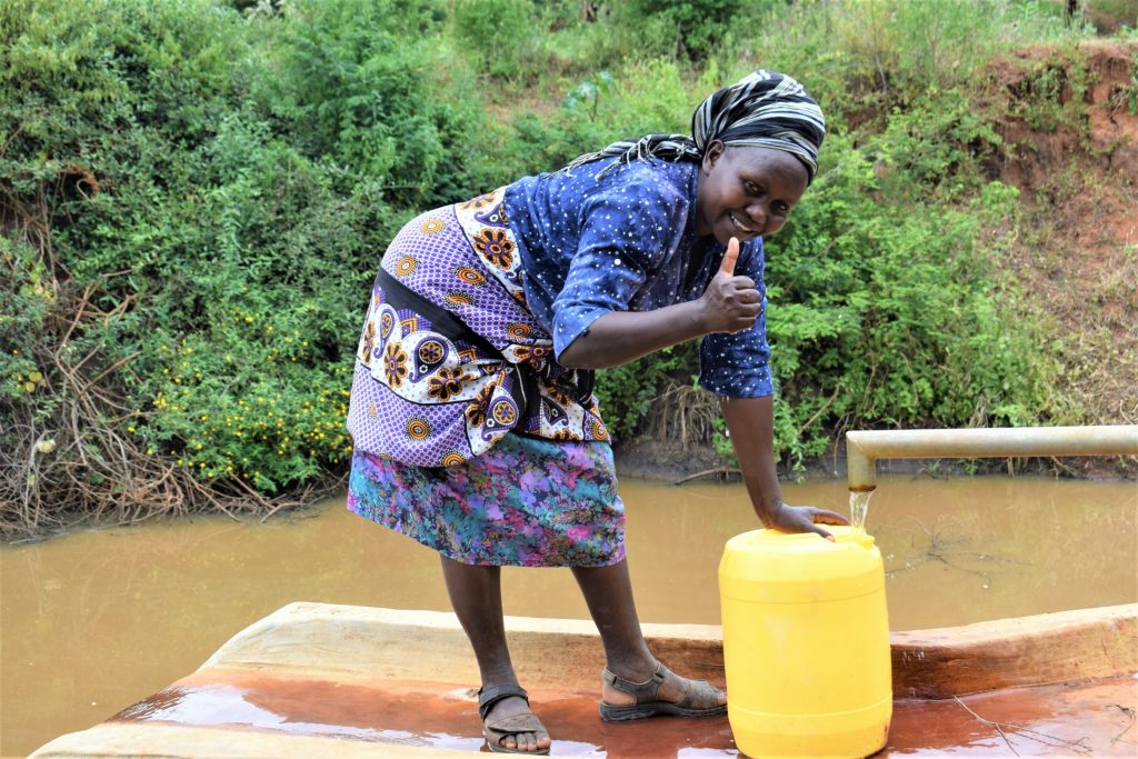 The Water Project : kenya18190-thumbs-up-a-year-later