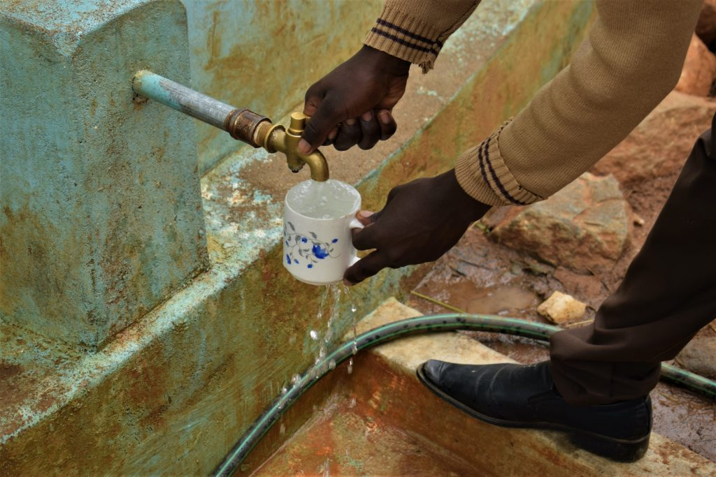 The Water Project : kenya18240-filling-up-cup-at-the-tank