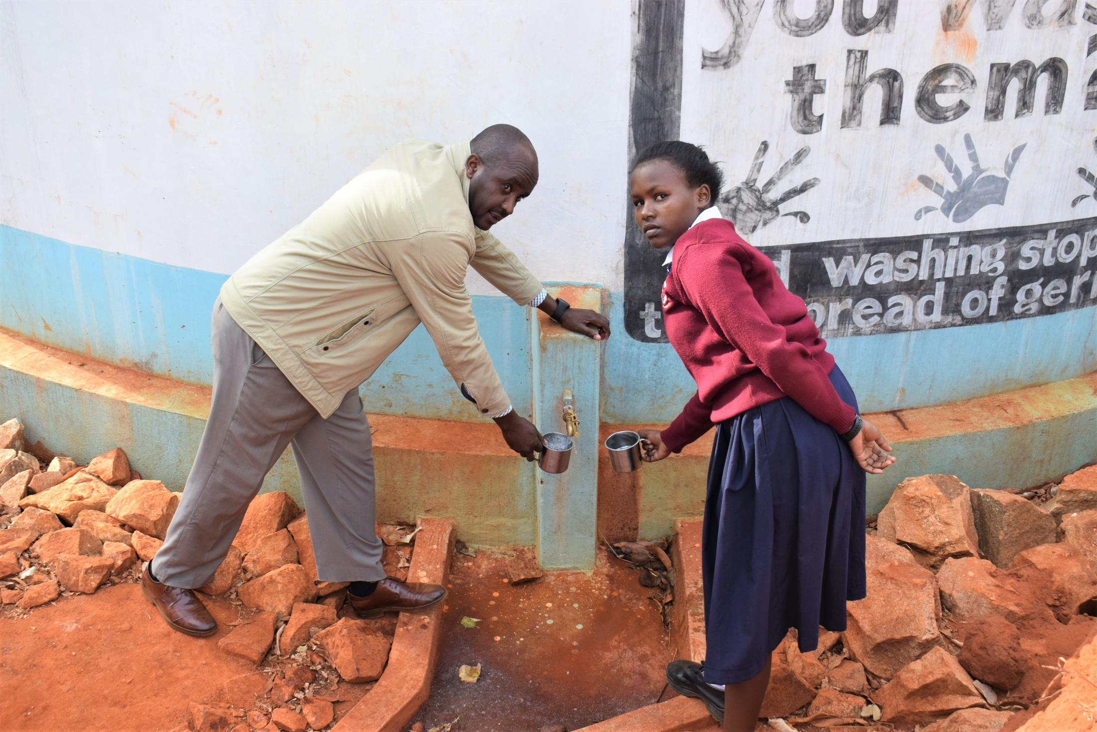 The Water Project : kenya18241-fetching-water-at-the-tank-a-year-later