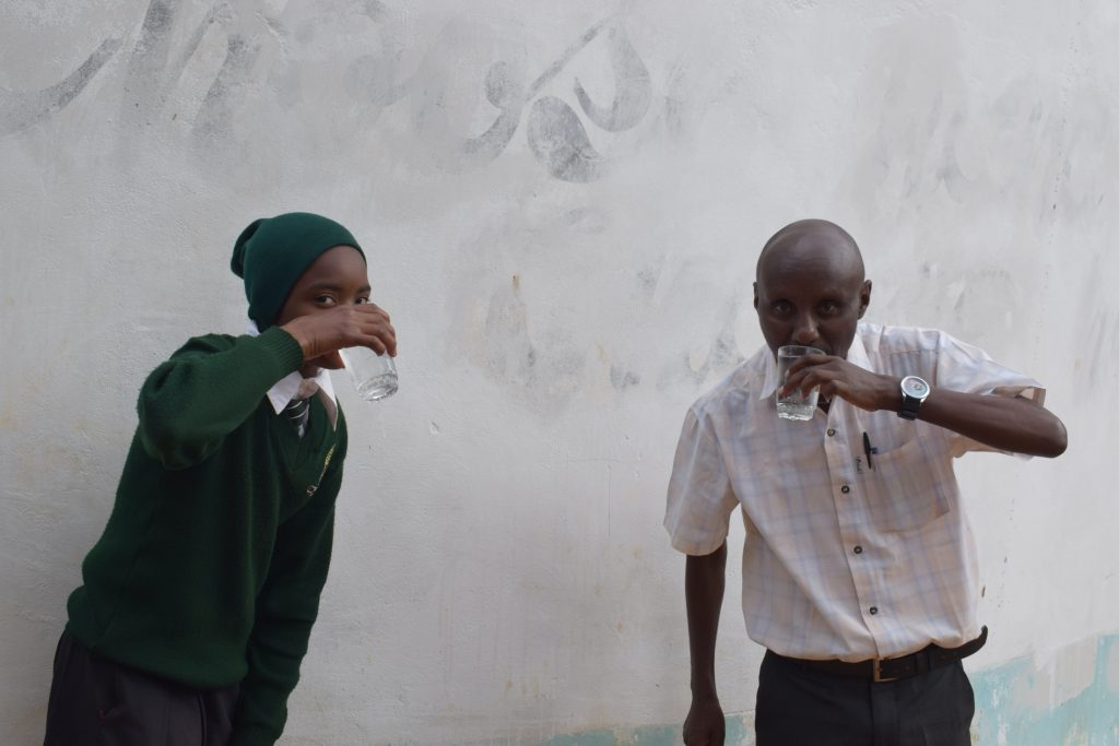 The Water Project : kenya18242-drinking-water-from-the-tank