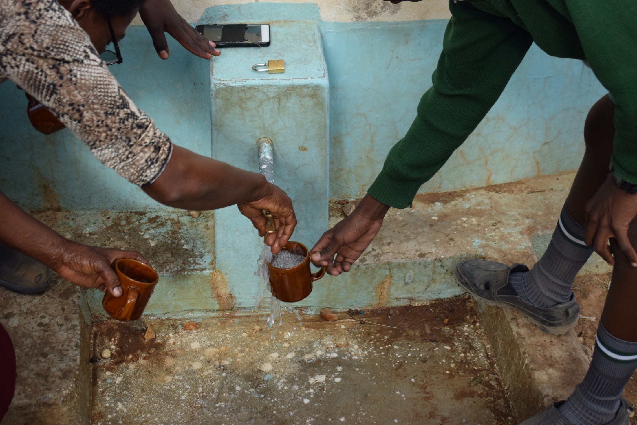 The Water Project : kenya18243-filling-up-cups-at-the-tank