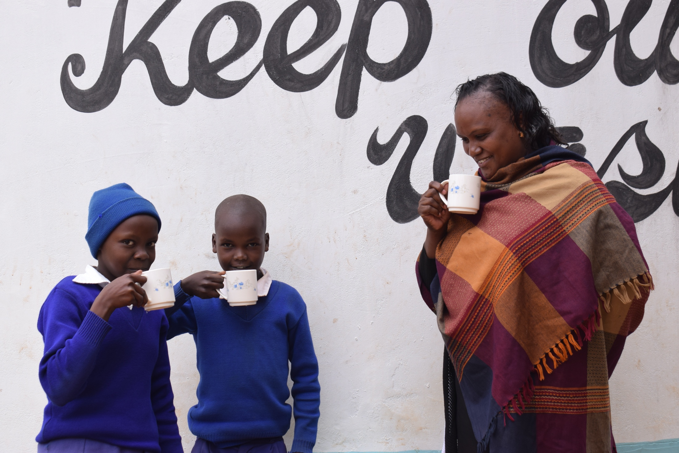 The Water Project : kenya18246-drinking-water-from-the-tank-a-year-later
