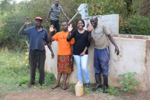 The Water Project:  Field Officer Kendi Poses With Community Members At The Well A Year After It Was Constructed