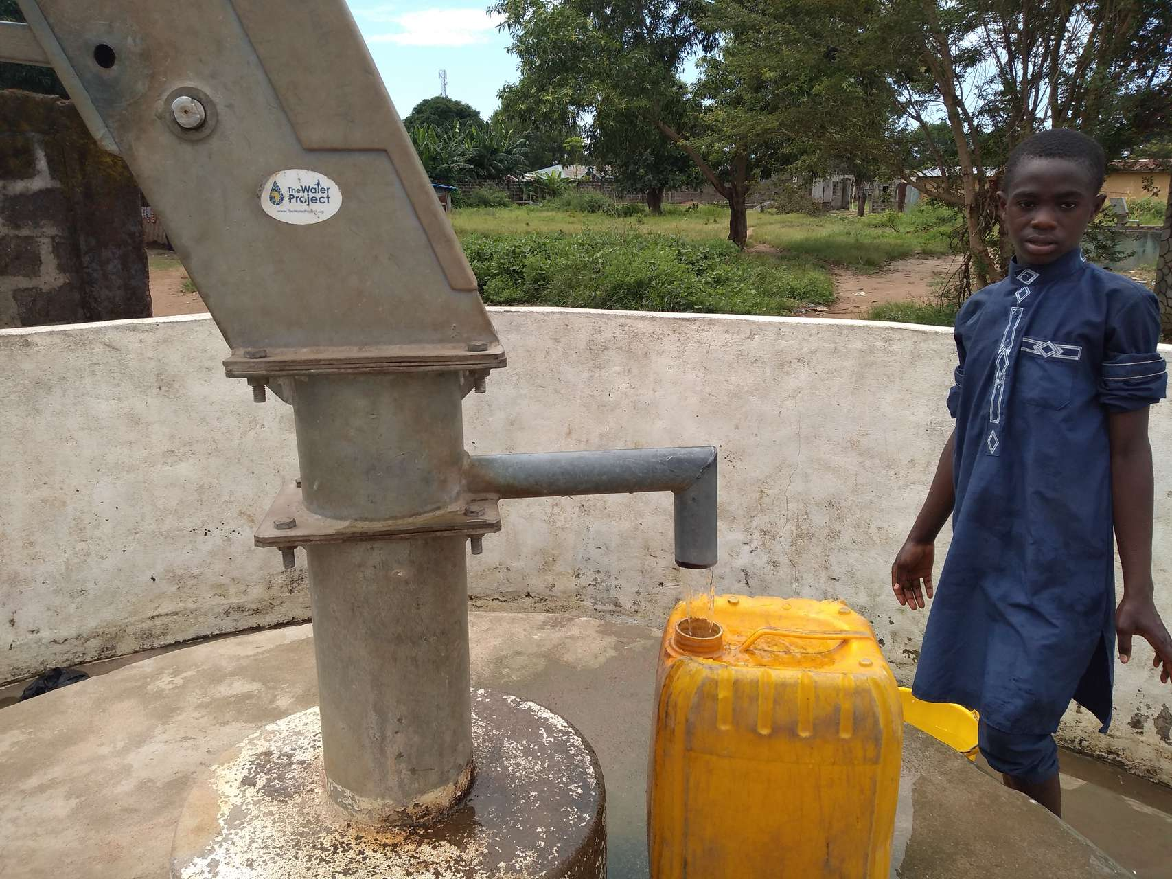 The Water Project : kenya18278-filling-up-at-well-a-year-later