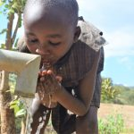 The Water Project: Masaani Community -  Drinking Water From The Well