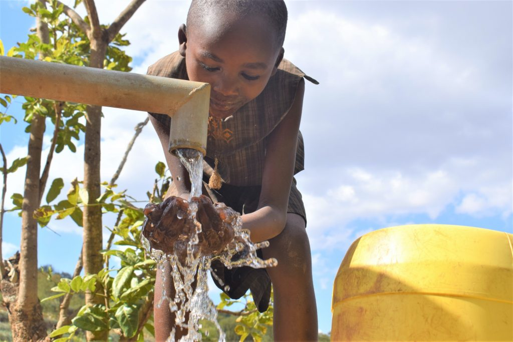 The Water Project : kenya19192-water-at-the-well-a-year-later
