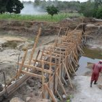 The Water Project: Kaukuswi Community -  Dam Construction Phase Two