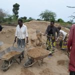 The Water Project: Kaukuswi Community -  Hauling Sand