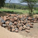 The Water Project: Kaukuswi Community -  Rocks For Dam