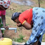 The Water Project: Maluvyu Community G -  Drinking Water From The Well