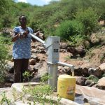 The Water Project: Maluvyu Community G -  Fetching Water At The Well