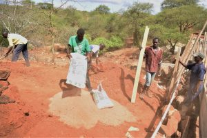 The Water Project:  Pouring Cement To Mix