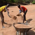 The Water Project: Maluvyu Community G -  Scooping Sand